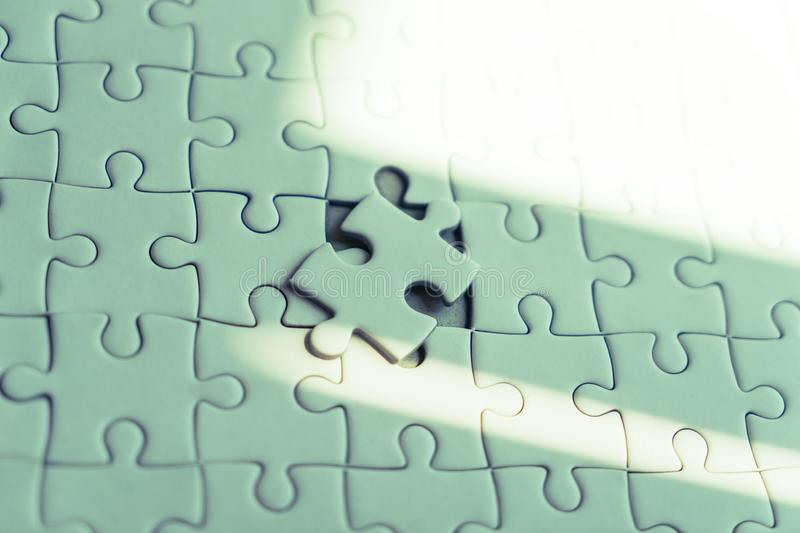 Placing last jigsaw for business solution concept royalty free stock image