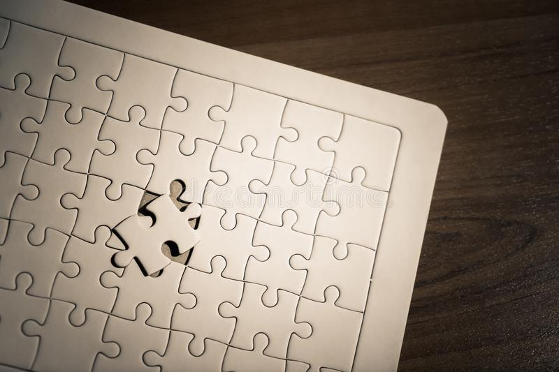 Placing last jigsaw for business solution concept royalty free stock photography