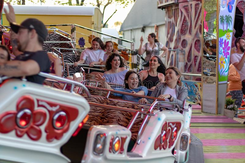 Plaerrer, Augsburg Germany, APRIL 22, 2019: young families enjoying their time with kids in a carnival ride stock images