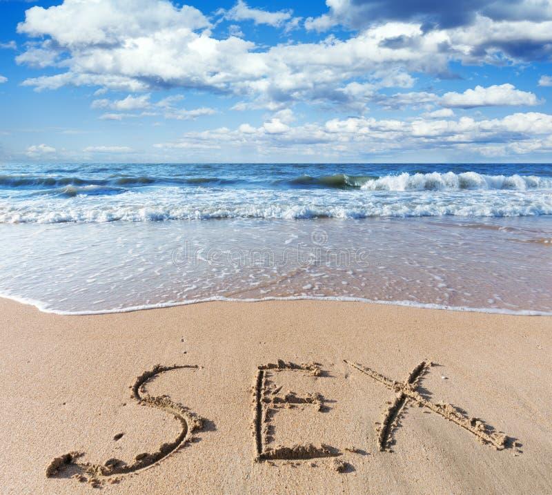 Plage avec le sexe de mot de sable photo libre de droits