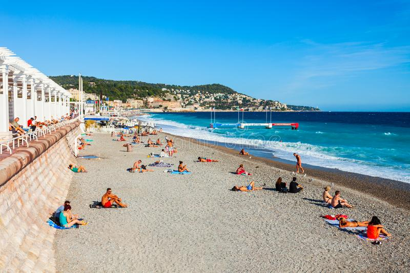 Plage Blue Beach in Nice, France. NICE, FRANCE - SEPTEMBER 25, 2018: Plage Blue Beach is a main beach in Nice city, Cote d\'Azur region in France royalty free stock photo