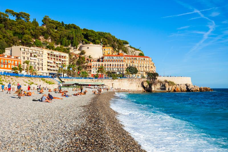 Plage Blue Beach in Nice, France. NICE, FRANCE - SEPTEMBER 25, 2018: Plage Blue Beach is a main beach in Nice city, Cote d\'Azur region in France stock images
