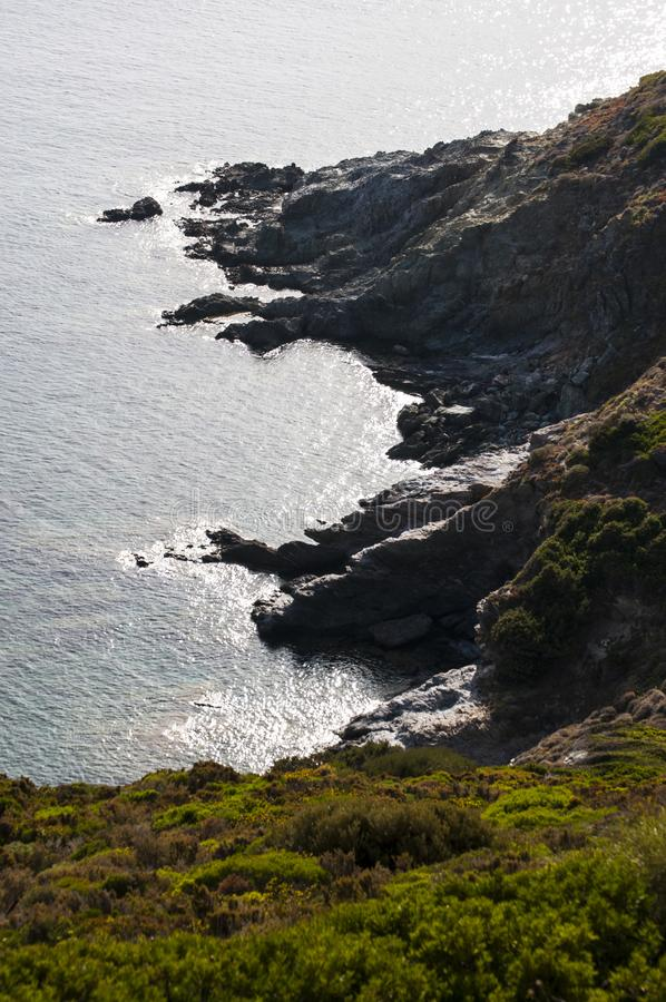 Plage d`Alisu, beach, Haute Corse, Cape Corse, Corsica, Upper Corsica, France, Europe, island. Corsica, 28/08/2017: cliffs and Mediterranean maquis at Anse d royalty free stock photography