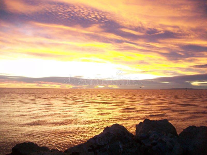 Plage da praia do por do sol de Coucher de soleil imagens de stock royalty free