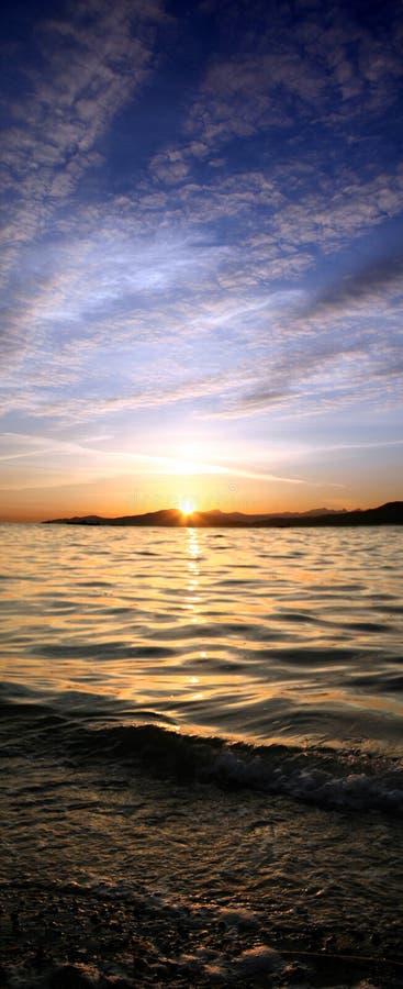 Plage de coucher du soleil image libre de droits