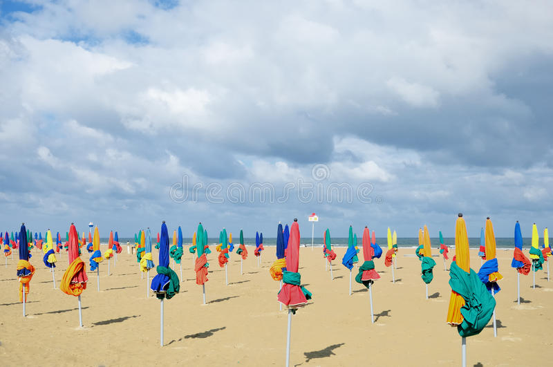 Plage a Deauville. It is rather fresh and windy, Deauville,Normandy Coast, France royalty free stock photo