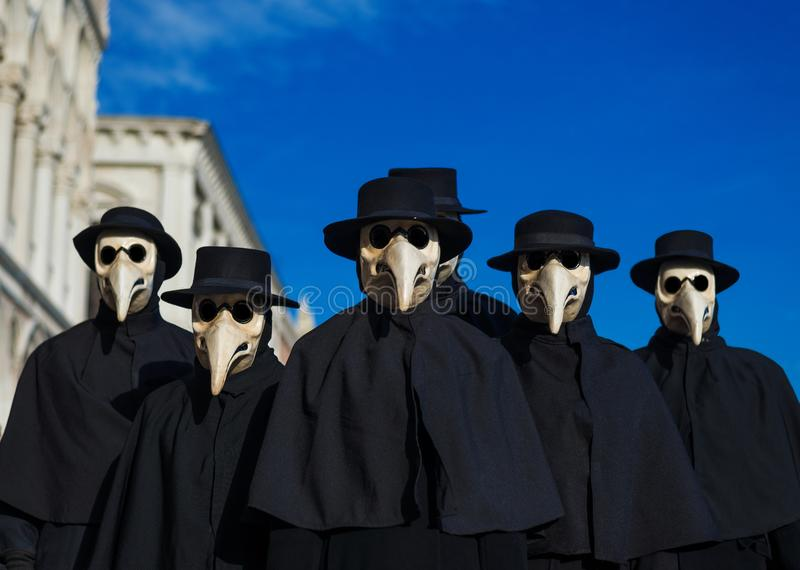 Plague Doctor Masks. Group, traditional costume invented in the 17th century and historical character of Venice Carnival stock images