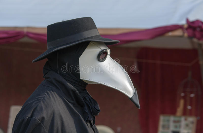 Plague Doctor. A Plague Doctor walking around royalty free stock photo
