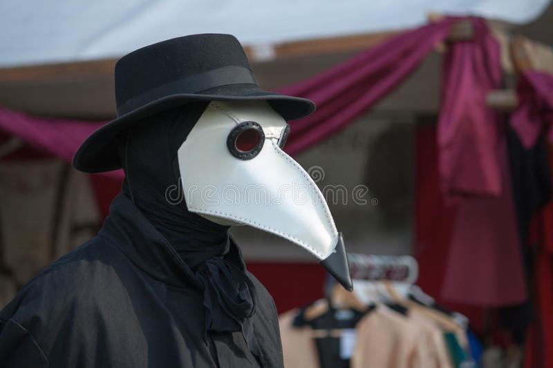 Plague Doctor. A Plague Doctor walking arround royalty free stock photography