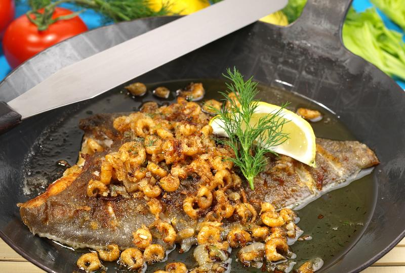 Plaice in a Pan with small Shrimps stock photo