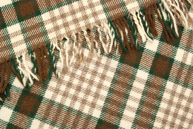Plaid contrôlé de laine et brun images stock
