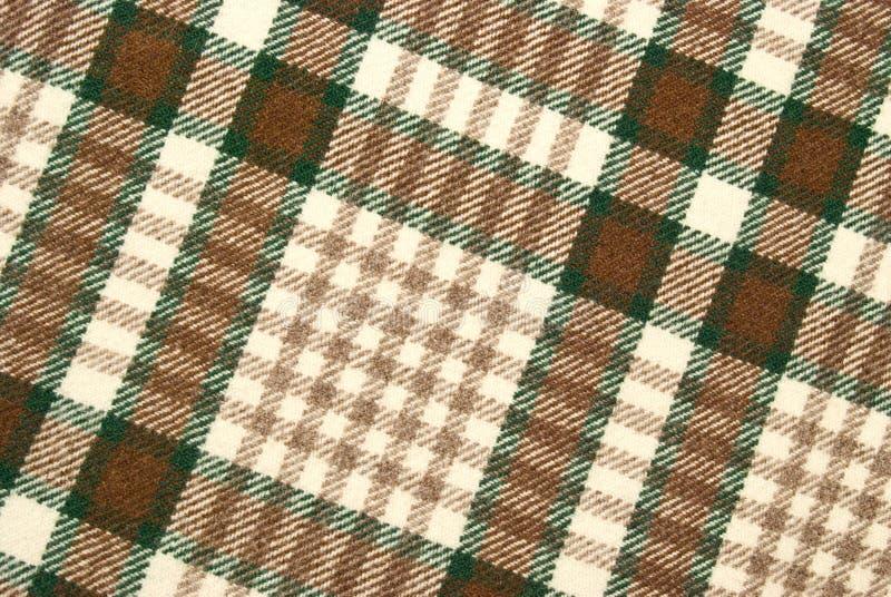 Plaid controllato di lana e marrone fotografia stock libera da diritti