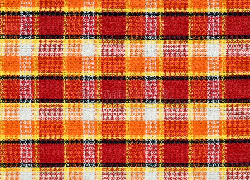 Plaid fabric pattern. Detailed texture of red-yellow-orange fabric pattern royalty free stock images