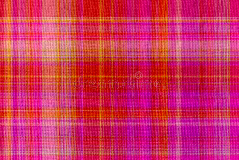 Plaid Textured Background. Plaid linen textured background in shades of pink and red stock photos