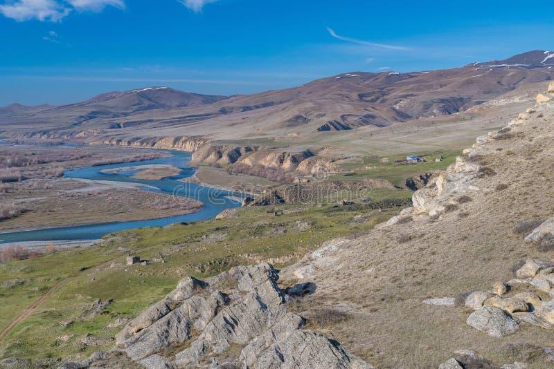 The plain below Uplistsikhe rock-hewn city and Mtkvari river.  stock image