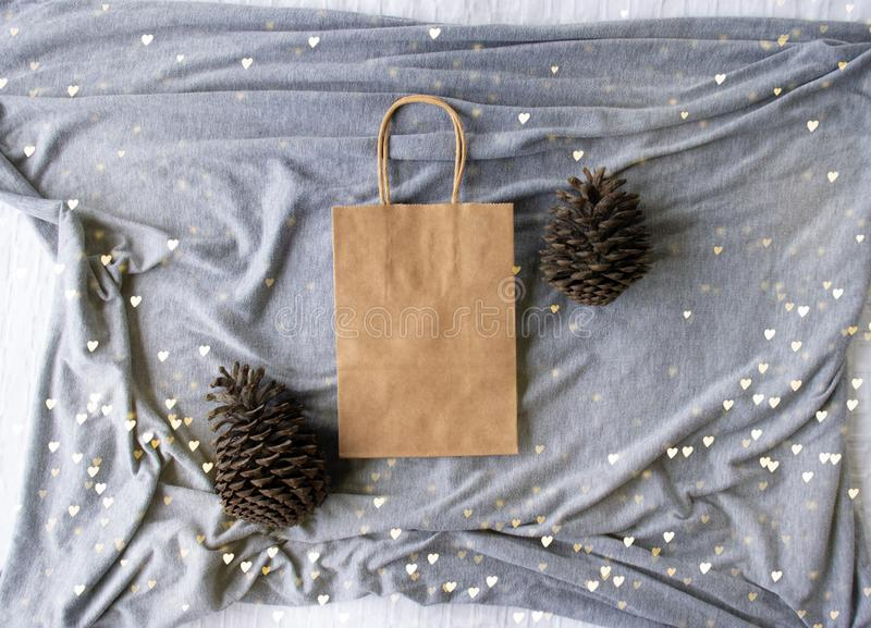 Plain blank brown paper bag with twinkle lights empty for own design. Winter Christmas bag mock up royalty free stock images
