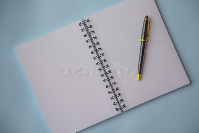 Plain empty notebook, on a blue background. With copy space royalty free stock photo