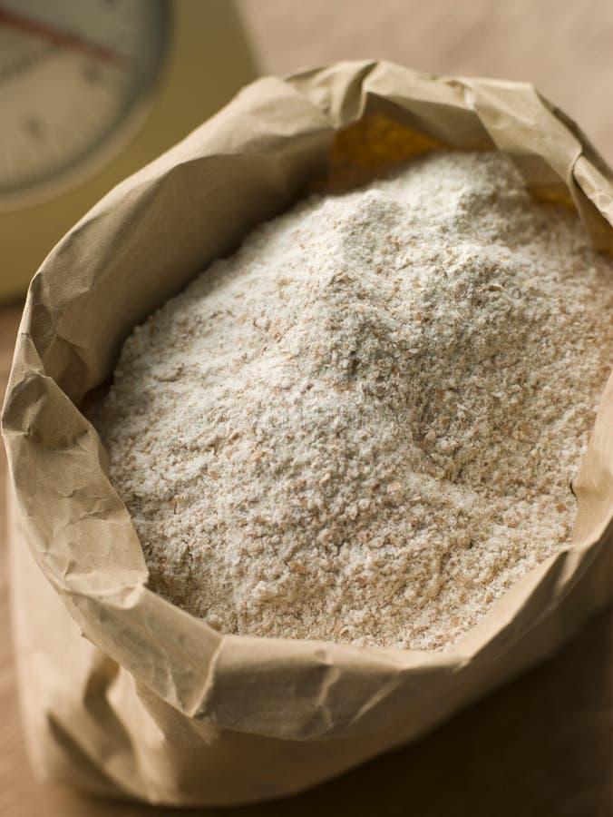 Plain a farinha no saco de papel imagem de stock