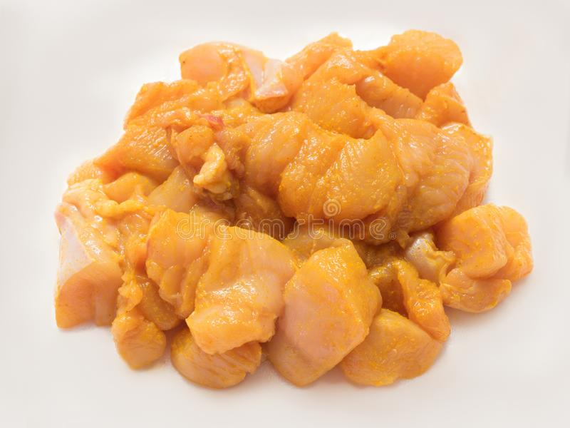 Plain Fresh Raw Skinless and Boneless Chopped Chicken marinette with salt and turmeric.  stock photos
