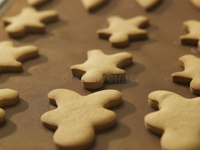 Plain gingerbread man. On the tray stock photos