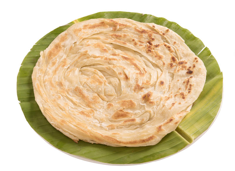 Plain paratha in a round shaped banana leaf isolated on white background stock photography