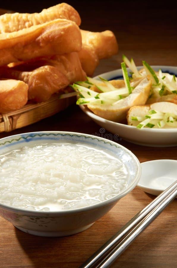 Plain Porridge. With traditional side dish royalty free stock photo