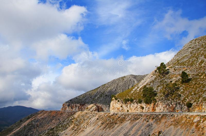 Plain road in the top of mountains, blue sky with the clouds, spring time. Spain royalty free stock images