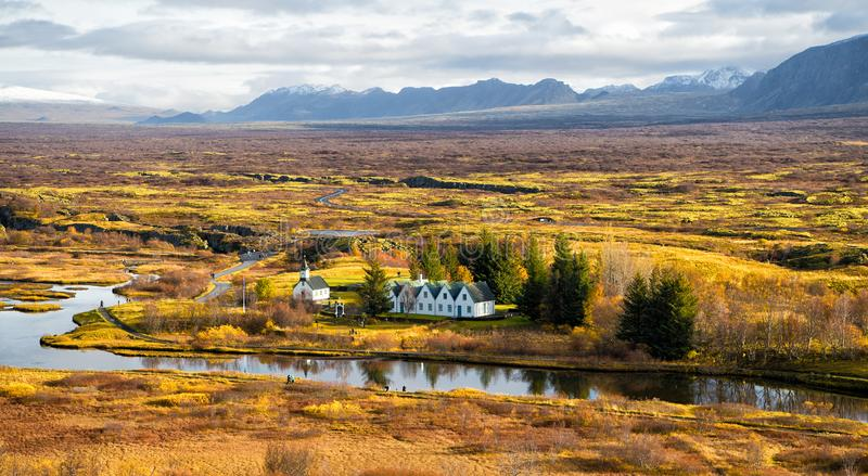 Plain thingvellir national park in reykjavik enters to the iceland golden circle. countryside with river, church, houses. On mountain landscape in Iceland. best stock photography