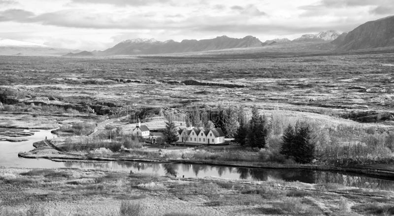Plain thingvellir national park in reykjavik enters to the iceland golden circle. countryside with river, church, houses. On mountain landscape in Iceland. best stock photo
