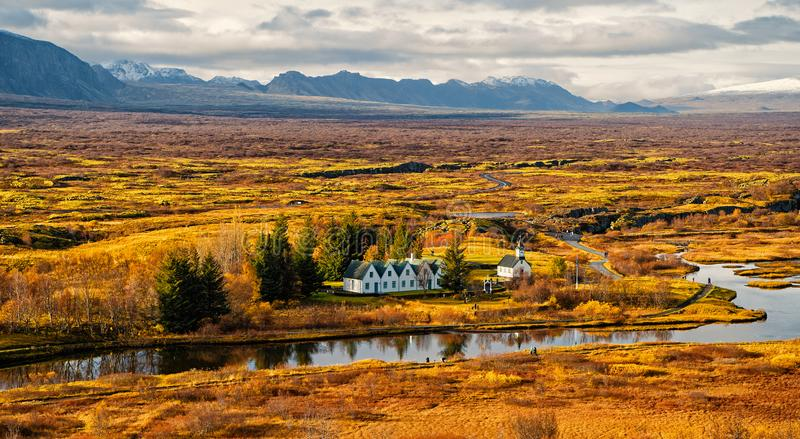 Plain thingvellir national park in reykjavik enters to the iceland golden circle. countryside with river, church, houses. On mountain landscape in Iceland. best royalty free stock photos