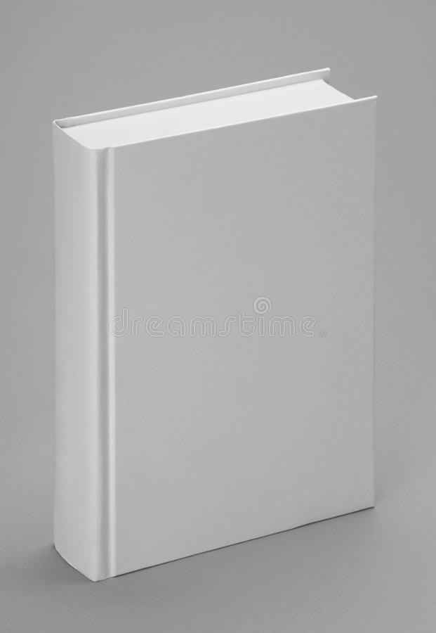 Plain White Book Cover : Plain white book standing with a grey backgound stock