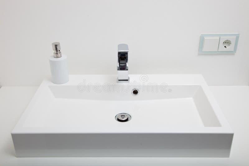 Plain white handbasin in a bathroom royalty free stock images