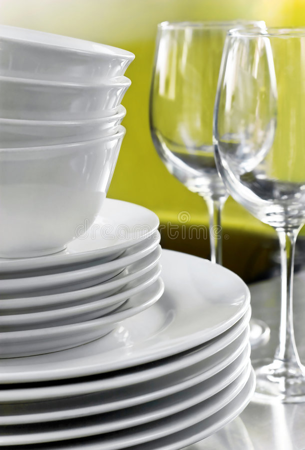 Plain White Plates Bowls and Crystal Wine Glasses stock photos