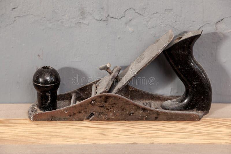 Plaina do metal do preto do close-up foto de stock