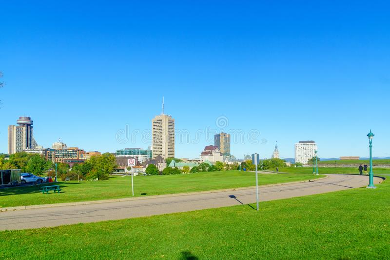 Plains of Abraham park in Quebec City. Quebec City, Canada - September 27, 2018: View of the Plains of Abraham park and city skyline, with locals and visitors royalty free stock photo