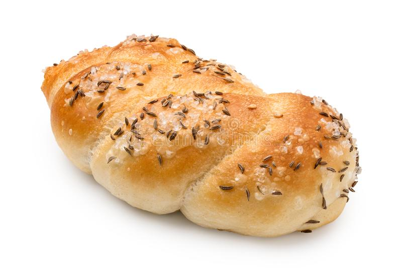 Plaited white bread roll with rough salt and caraway seeds isolated on white.  stock photography