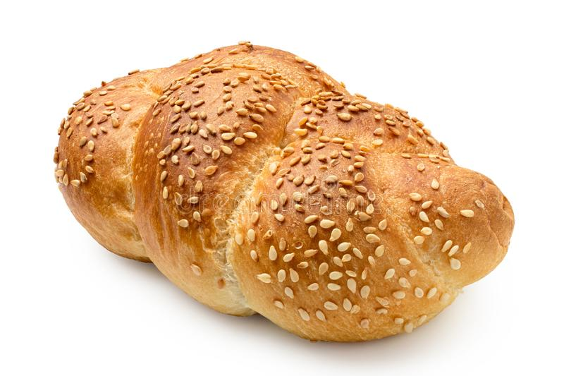 Plaited white bread roll with sesame seeds isolated on white.  royalty free stock photos