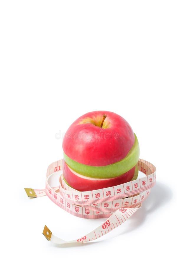 Plak rode en groene appel met taillemaatregel royalty-vrije stock fotografie