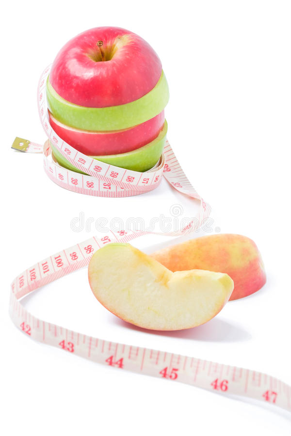 Plak rode en groene appel met taillemaatregel royalty-vrije stock afbeelding