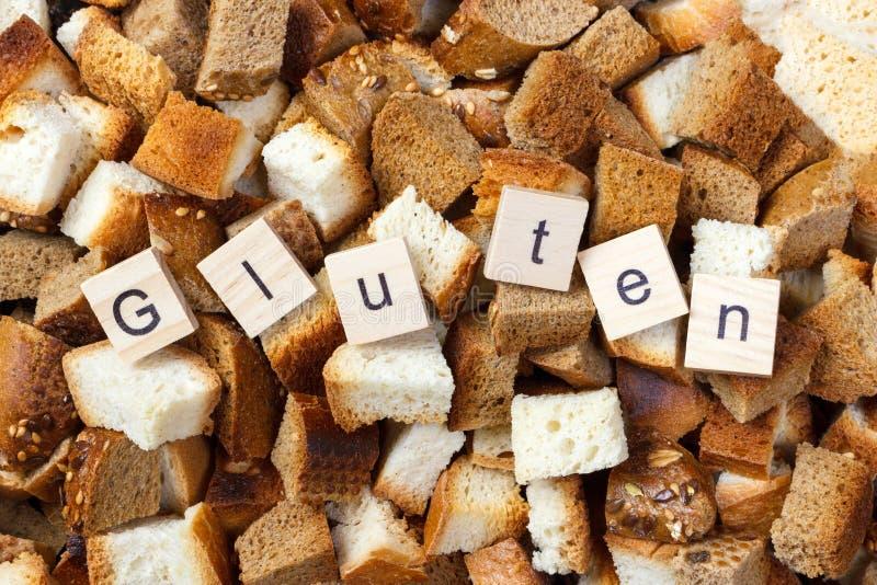 Plak van beschuitbrood met het concept van de Glutentekst stock fotografie