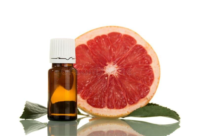 Plak van grapefruit en aromatische vloeistof voor het roken stock foto
