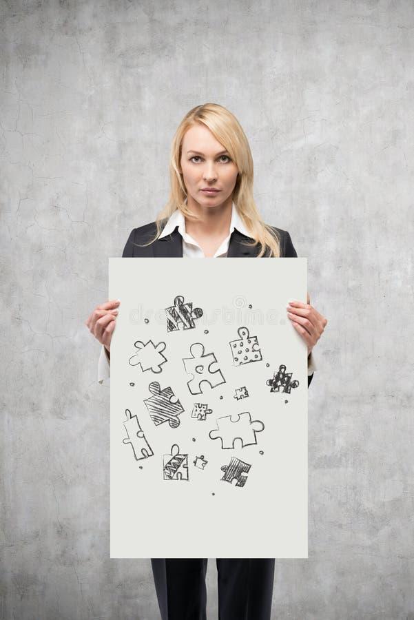 Plakat med teckningspusslet royaltyfria foton