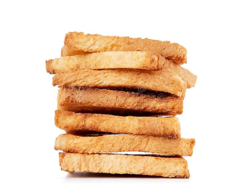 Plakken van geroosterd die brood, op witte achtergrond worden ge?soleerd Het dossier bevat een weg aan isolatie royalty-vrije stock foto