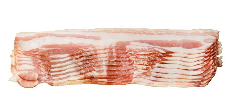 Plakken van heerlijk bacon op een wit geïsoleerde achtergrond Close-up stock afbeeldingen