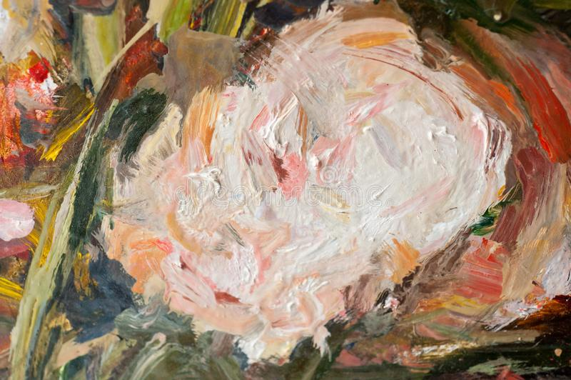 Plakken van heldere olieverf op het schot van het canvasclose-up stock afbeelding