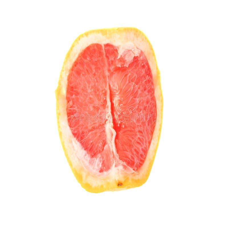Plaksectie van grapefruit over de witte achtergrond wordt geïsoleerd die royalty-vrije stock fotografie