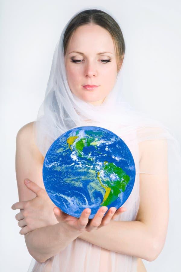 Planète dans les mains image libre de droits