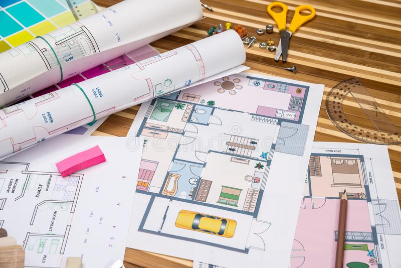 Plan of apartment rooms and blueprint rolls. With work tolls royalty free stock images