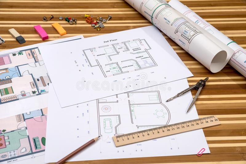 Plan of apartment rooms and blueprint rolls. With work tolls stock photography