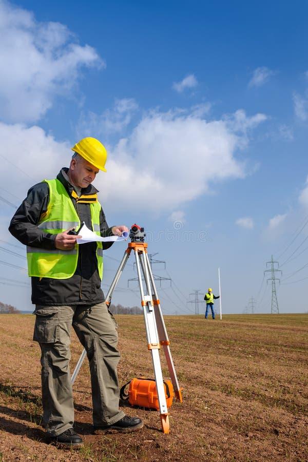 Plan de construction de regard de cordon de mesure de Geodesist photo stock